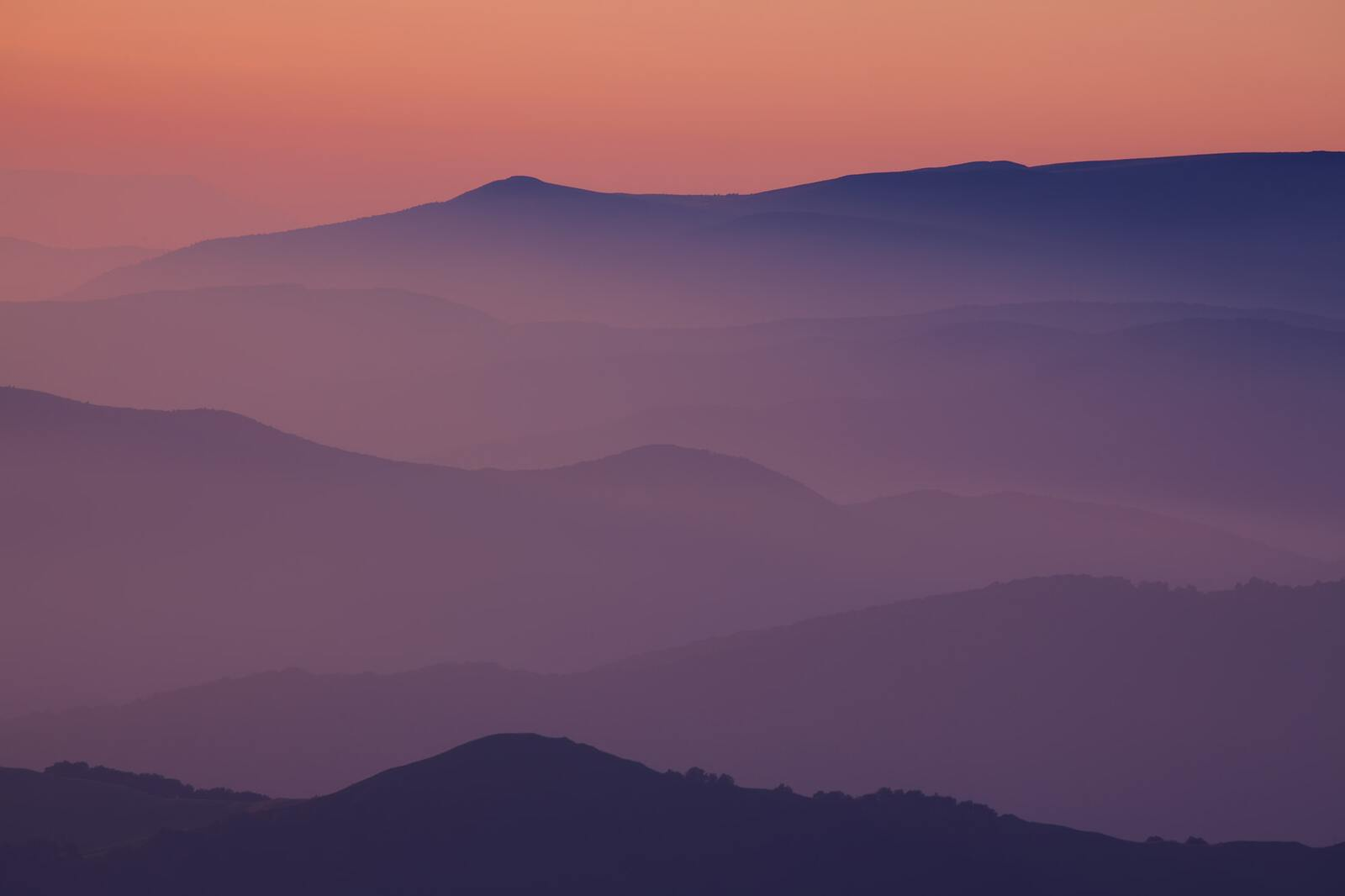 Silhouettes of the mountain hills at sunset